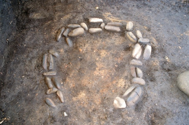 Hearth with circular stone arrangement