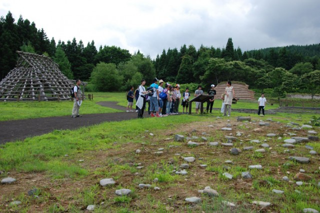 Visitors viewing the ruins at the Ofune Site