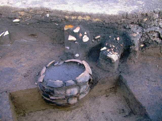 Buried pottery (during excavations)